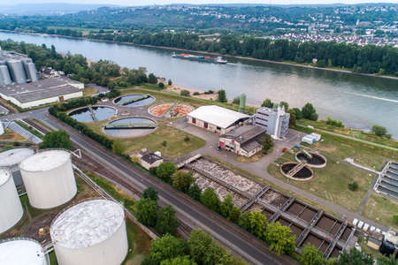 Koblenz GERMANY 21.07.2018 Aerial view of modern industrial sewage treatment plant beside the rhine river Editorial
