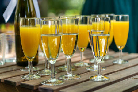 sparkling wine in glasses with orange juice in restaurant or on a party dinner setting Stockfoto