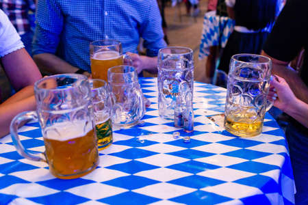 Koblenz Germany -26.09.2018 Close-up of bavarian beer glasses 1 liter bitburger Beer on table decoation at Octoberfest Editorial