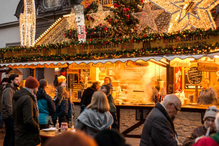 Koblenz GERMANY 16.12.2017 imbiss selling food meat and sausages Traditional Christmas market by night Editorial