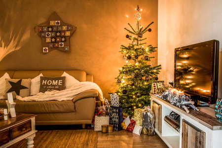 Merry Christmas beautiful living room tree setup aith gifts decorated for Happy Holidays at home Stock Photo
