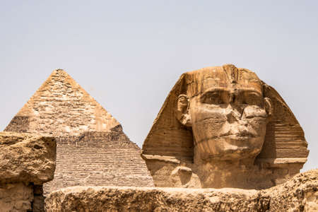 Egyptian Great Sphinx full body portrait head,with pyramids of Giza background Egypt empty with nobody. copy space Stock Photo