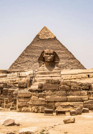 Egyptian Great Sphinx full body portrait head,with pyramids of Giza background Egypt empty with nobody. copy space