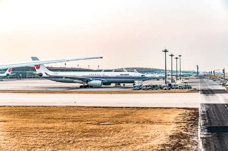 Bejing, China, 23.02.2019 Air China Airbus twin-engine jet airliner standing at the airport waiting for flight Editorial