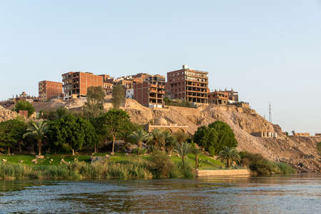Aswan city Egypt panorama view from a boat on the west coast of the Nile on a sunny day