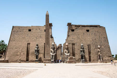 Statues in front of Entrance to Luxor Temple, Ancient Egyptian temple complex east bank Nile River ancient Thebes