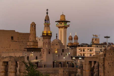 catholic Church and Muslim Mosque Tower religion Symbols together in Luxor temple at sunset