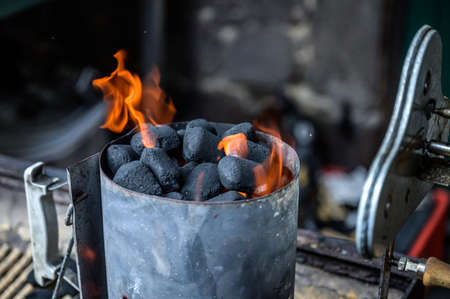 BBQ Grill Pit Glowing And Flames Hot Charcoal Briquettes coal Food Background Or Texture Close-Up Top View