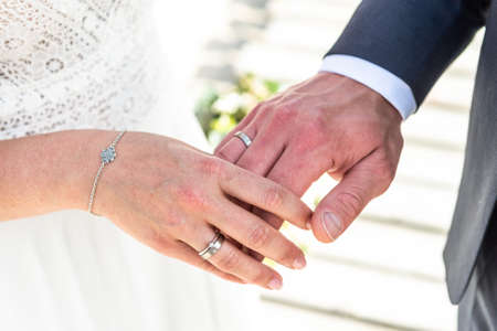 hands groom and bride with wedding rings celebration