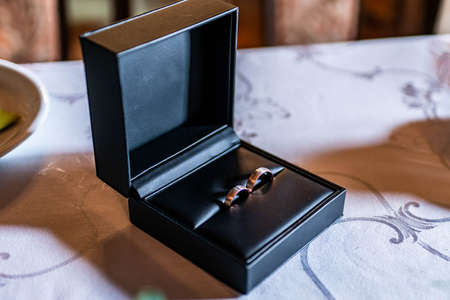 Romantic marriage couple wedding Symbols rings in a black box on a table Banco de Imagens