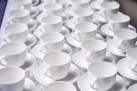 Abstract blurred many stacked rows of coffee tea cups