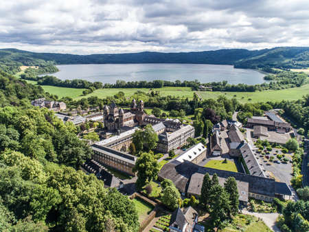 Aerial view on Laacher See behind the famous abbey Maria Laach in Rhineland-Palatinate, Germany Stock Photo