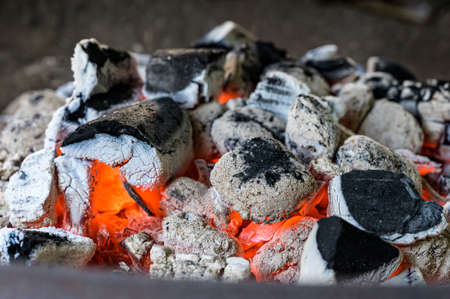 BBQ Grill Pit Glowing And Flaming Hot Charcoal Briquettes coal Food Background Or Texture Close-Up Top View Stock Photo