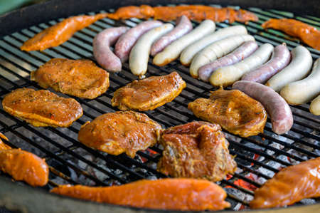 Barbecue grill bbq on coal charcoal grill with steaks bratwurst sausages and meat delicious summer meal