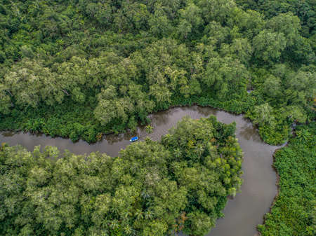 Aerial view of boat in the mangrove Rio Sierpe river in Costa Rica deep inside the jungle
