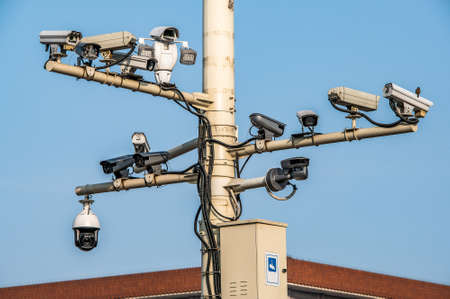 CCTV cameras on lantern pole in the capitol city of china Bejing. Concept of security, surveillance, being watched