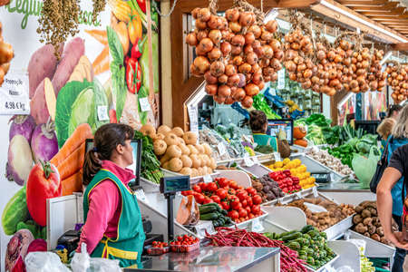 FUNCHAL, PORTUGAL 27.10.2018 Fresh exotic vegetables on famous market in Funchal Mercado dos Lavradores Madeira island