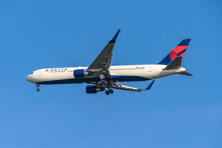 FRANKFURT GERMANY 11.08.2019 USA Delta AIRLINES Boeing 767-332 approaching to fraport airport for Landing on Blue sky