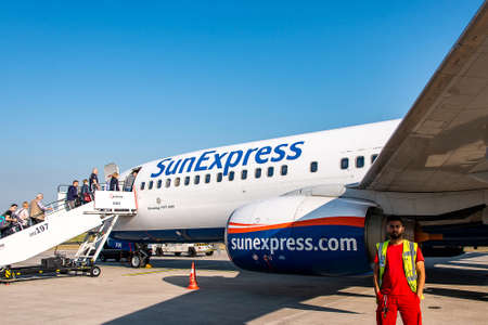 Frankfurt Germany 16.05.18 SunExpress Airline airplane jets people boarding on the airport ready for takeoff.