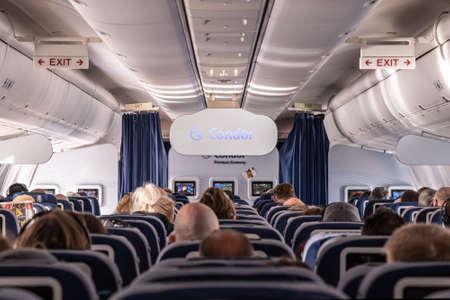 Frankfurt Germany 18.11.19 Condor Air airplane logo passengers and Board Crew inside a Boeing Airplane.