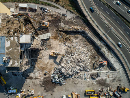Aerial view of Building House Demolition and construction site Excavator with hydraulic crasher machine