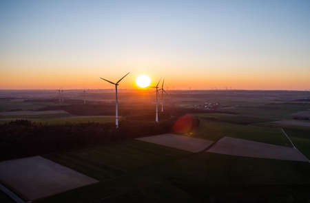 Aerial view of windturbines energy generator on amazing sunset at a wind farm in germany