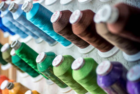 closeup of Colorful Spools of Thread yarn Sewing Equipment, Fabric and Textile Industry
