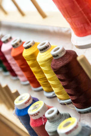 08.07.2018 -Koblenz Germany - Closeup of Colorful Spools of Thread yarn Sewing Equipment, Fabric and Textile Industry Reklamní fotografie