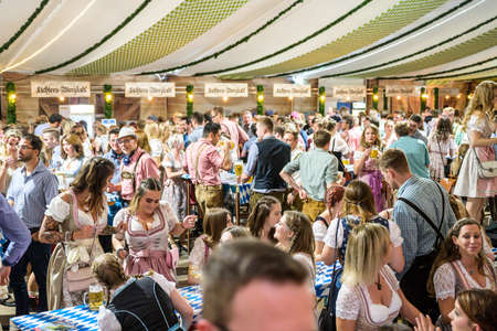 Koblenz Germany 27.09.2019 people party at Oktoberfest in europe during a concert Typical beer tent scene