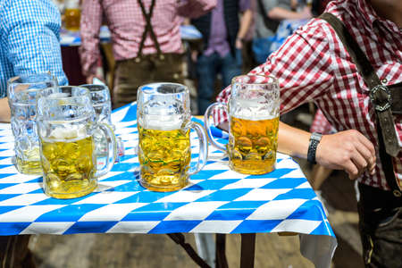 Koblenz Germany 27.09.2019 Close-up of bavarian beer glasses 1 liter bitburger Beer on table decoation at Octoberfest