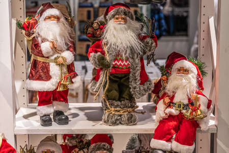 Close up of different red Santa Claus figures christmas decoration puppets