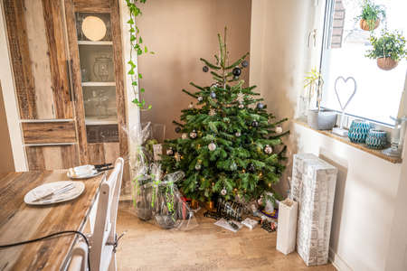 Merry Christmas beautiful living room tree setup gifts package decorated for Happy Holidays at home