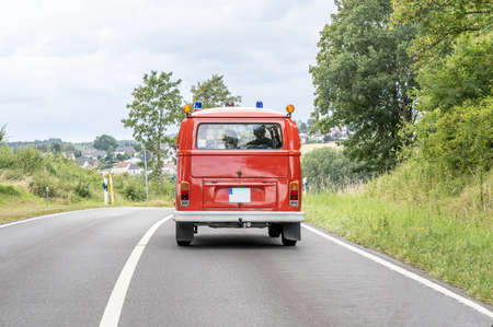 Ochtendung Germany 25.05.2019 VW T1 fire engine red firefigther car Oldtimer classic car drivin on the Road