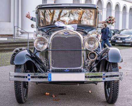 Koblenz Germany 12.12.2019 Wedding Couple in Oldtimer Ford Typ A Tudor Sedan 1928 during a Wedding Decorated Editorial