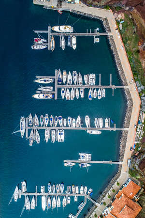 The drone aerial view of sailing yachts moored in marina Quinta do Lorde on coast of the Portuguese island of Madeira Banco de Imagens