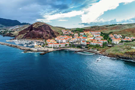 Aerial view of Quinta do Lorde smal village hotel on coast of the Portuguese island of Madeira with small yacht harbour