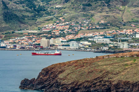 Mountainside view city carnical industry harbour near Funchal, Madeira