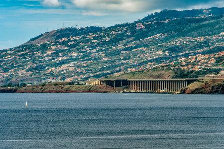 Coastline Madeira with Highway along Santa Cruz and a view at the airport runway near funchal