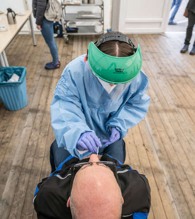 14.04.2021 Coronavirus COVID-19 diagnostic - Medical worker performing nasal swabbing test