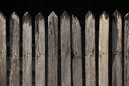 picket: Unpainted old wooden Picket fence Stock Photo