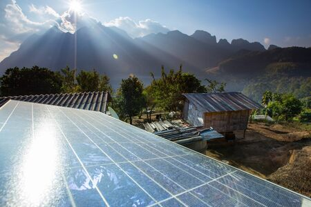 carbon neutral: Mountains behind Solar panels Stock Photo