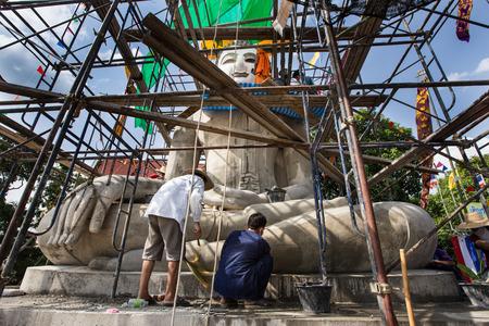 buliding: CHIANG MAI THAILAND  MAY 26 2013: Buliding a Buddha statue in Chiangmai Thailand