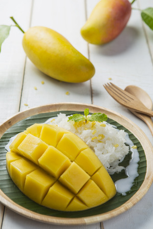 Dessert sweet sticky rice with mango coconut milk photo