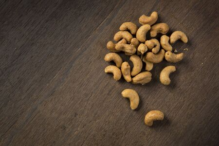 Cashews on a wooden background Stock Photo