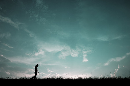 ifestyle: Silhouette of girl walking Stock Photo