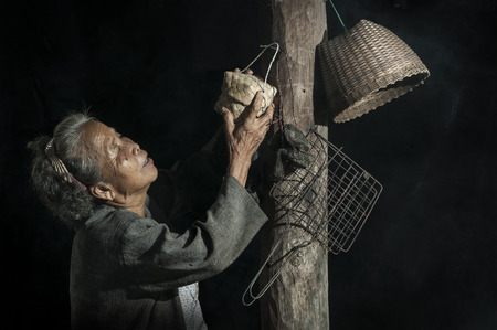 old asian: Grandmother or mother in the kitchen
