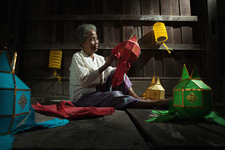 underdeveloped: Thai old women made the lantern for yeepeng festival