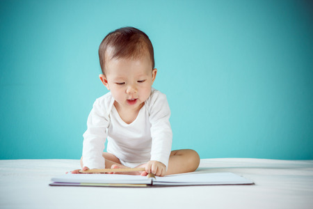 Little girl writing in her book Stock Photo