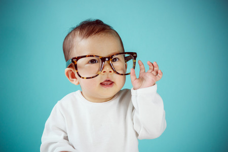 baby girl: Little baby with Glasses new family and love concept. Stock Photo