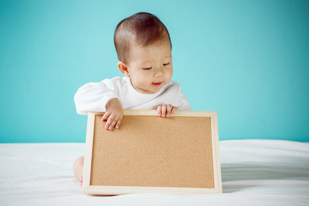 child holding sign: Baby with Blank Board studio shot